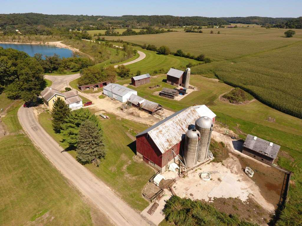 Farms like this do not come up very often.  198 acre farm in town of Cross Plains with a 2900 sq. ft.  stone farm house built in mid 1800?s,  36x112 barn, 36x64 metal pole shed along with many other buildings.  Of the 198 acres, 129 are tillable, 65 pasture, and remainder is wooded.  The land is rented for the 2018 crop season.  The Black Earth creek runs through the property on the North and the Southeast portion of the property borders the Cross Plains State Park.  The location has easy access to Hwy 14 and just minutes from the Village of Cross Plains.