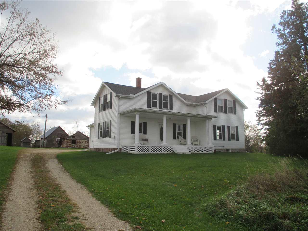 Country farmhouse on 76 acres of prime hunting land in the heart of Marquette County.  Main level offers updated kitchen, large dining room with maple wood flooring and a beautiful built in hutch, living room and main floor bedroom.  Upper level offers 3 nice size bedrooms.   Enjoy the peach, cherry, apple and pear trees.  Dual wood or forced air heat source to save on the utility costs. New roof on home in 2018!  Partial basement.  Some older farm buildings.  Very private location.