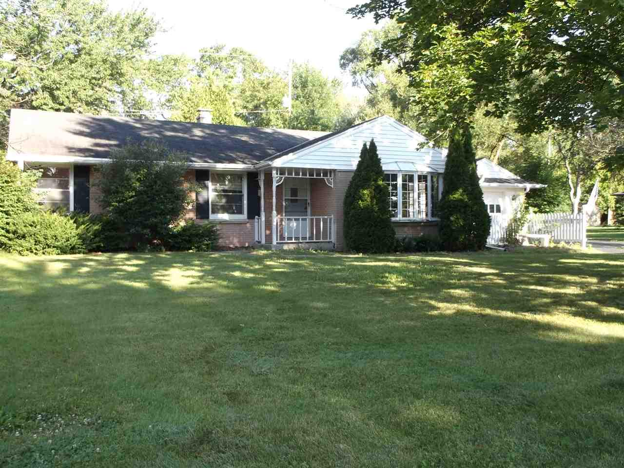 Ranch home on a quiet street, has larger rooms, basement and a garage. Home needs some updating but is in good shape. The house even has a fireplace! Sq footage approx.
