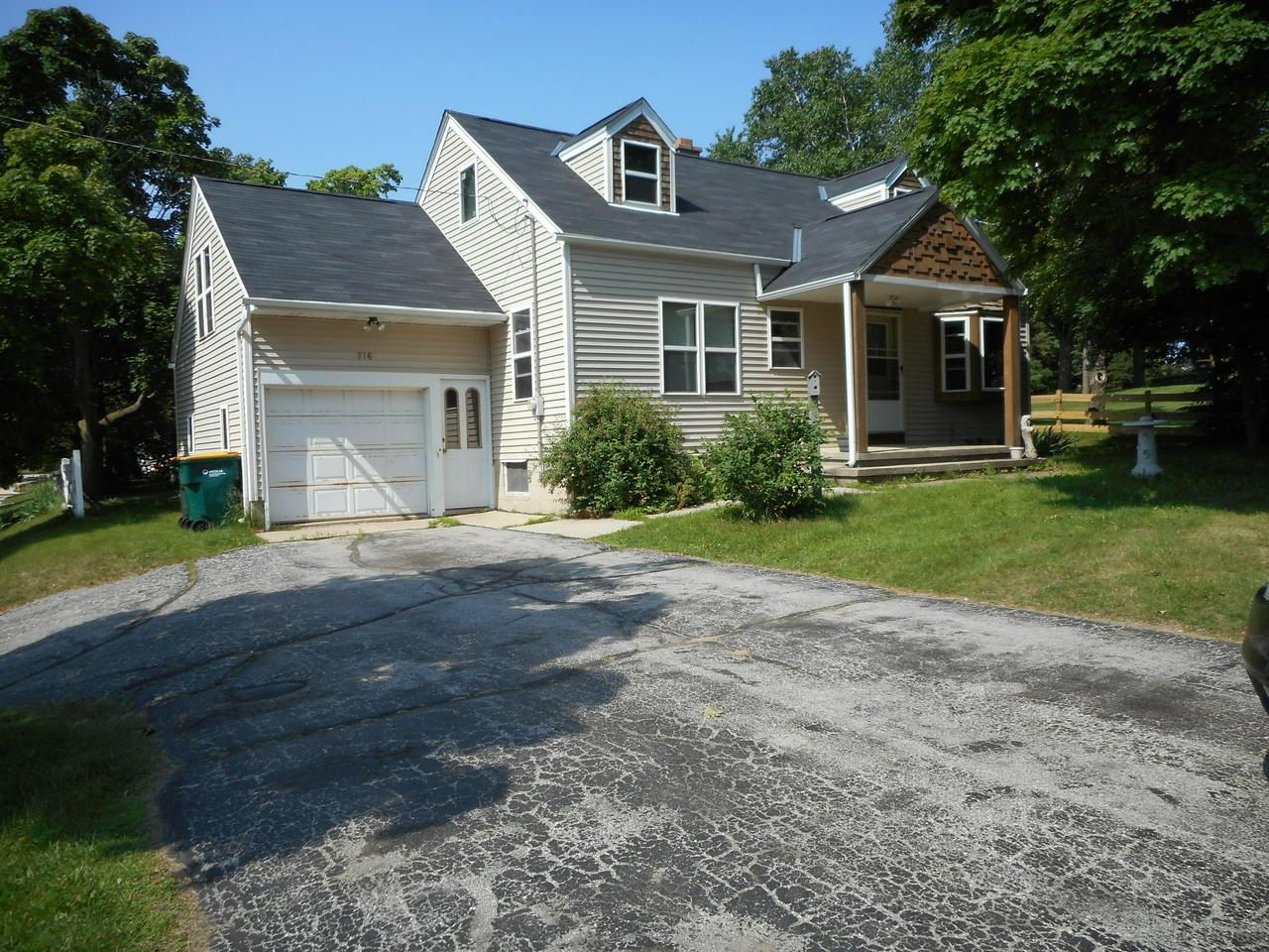 2 bedroom Cape Cod with newer windows, window trim and siding. Eat-in kitchen with loads of cabinets. 2 bedrooms are on the main floor plus the room above the garage was used as a bedroom. Possibilities for expansion in the attic area and potential rec room and 1/2 bath located in the basement. 1 car attached garage, nice sized yard plus a 12x12 storage shed. Could use some TLC. Sold as-is.
