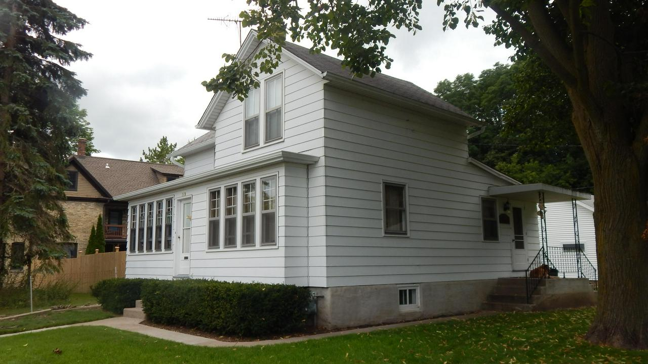 Located next to public library, down hill from Port Washington High School and Water Park & Pool, Walking distance to Marina / Lake Michigan, downtown restaurants and entertainment. Home features 3 bedrooms, 1 bath, Den / Office and Kitchen. Full Basement with interior & exterior entry. Aluminum Siding, double hung windows with combination storms & screens, enclosed screened front porch, nice yard with garden and raspberry patch.