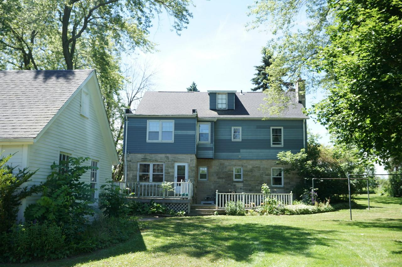A Rare Find! This ''Diamond in the Rough'' awaits your creative ideas to make this your Dream Home! Beautiful & Wooded 4.75 Acre parcelzoned Residential, however, buyers to contact Town for possible Commercial use. Unique 2 Story w/separate living quarters on upper floor.Hardwood Floors, Natural Fireplace, Natural Woodwork, Plaster Crown Moldings boast the unique craftsmanship. Super location, close to Freeway, Shopping, Restaurants, Schools & Interurban Bike Path. Schedule your showing today! Additional tax key #070161200300