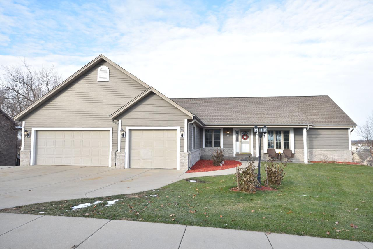 Downhill ski at Crystal Ridge, water ski on Pike Lake, or golf world famous Erin Hills. Escape to this 5BR, 3BA contemporary ranch home w/walk-out lower level! Cradled in one of the most spectacular settings you can imagine with incomparable views of the city of Hartford from your extra large deck. You will marvel at the feeling of light and spaciousness of the free-flowing floor plan filled with every conceivable luxury: soaring ceilings, a gourmet kitchen with 2018 new stainless steel appliances, glistening hardwood floors, newer carpet, expensively updated baths (2018), elegantly finished lower level kitchen, dual zone heating and an air purifying system. No expense was spared in construction or updating. Schedule your showing today and start your New Year in elegance.