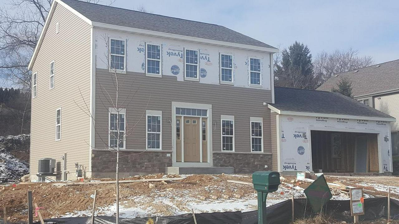 New Construction. Carefully balanced Open Concept 3 BR, 2.5BA, w/High Quality Finishes throughout. 10' Ceilings, knockdown drywall w/radius corners, Kitchen w/granite countertops Island/Snack Bar, Walk in Pantry w/Barn Door & on/off motion switch, Gas FP in GR, Main Fl laundry w/cabinets/shelf & full size closet. Laminate Flooring on Main Level. Master BR w/vaulted ceiling, WIC. Master Ba w/walk in ceramic shower/dual vanity/granite/tile flooring. WIC's & ceiling fans w/lights in all bedrooms. Open Staircase to LL. Full size window in LL.  Future bath plumbed in LL. Soft Closure Cabinetry, Decorative Plant Shelves/Niches throughout home. Upgraded Garage Door w/opener & keyless entry pad.
