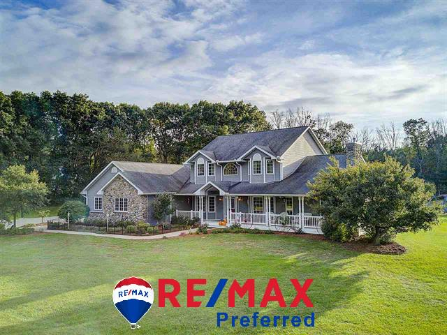 "FIRST TIME OFFERED! A ONCE IN A LIFETIME OPPORTUNITY TO OWN THIS CUSTOM BUILT ESTATE NESTLED ON 35 ACRES OF PRIVACY AT IT?S FINEST. JUST MINUTES TO LAKE WI & WALKING DISTANCE TO ROWAN CREEK FISHERY AREA W/ENDLESS HIKING, TROUT FISHING, CANOEING & BIRD WATCHING & TO I90-94 FOR THE COMMUTE TO MADISON OR WI DELLS. 5+ BEDROOM HOME HAS A ""DREAM KITCHEN"" DESIGN, CHERRY CABINETS, DOUBLE OVENS. CUSTOM WOODWORK, HARDWOOD OAK FLOORS, ZONED HEAT & AC, GORGEOUS GREATROOM, MAIN LEVEL MASTER STE, PATIO & WRAP AROUND PORCH FOR ENJOYING THE PEACEFULNESS & WILDLIFE. PROPERTY IS A HUNTERS DREAM OR PERFECT FOR HORSES."