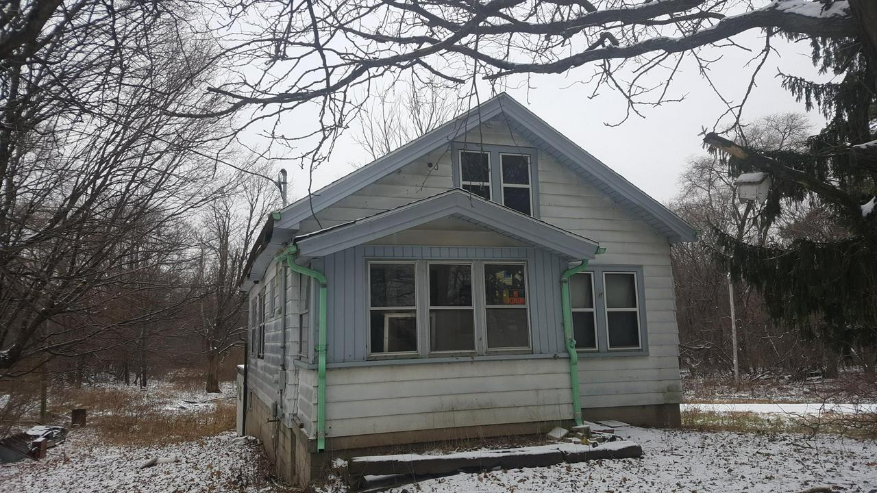 Enjoy COUNTRY LIVING in the town of Erin!  This cute 2 bedroom home is located on a quiet road and is Priced to Sell! Updated roof (8 years ago), enclosed front porch,  pantry off kitchen, 2 car garage and hardwood floors in living, dining & bedrooms are some features.  Needs updating but is a Great Opportunity for the handy person! (Square footage & year built per AssessorData)