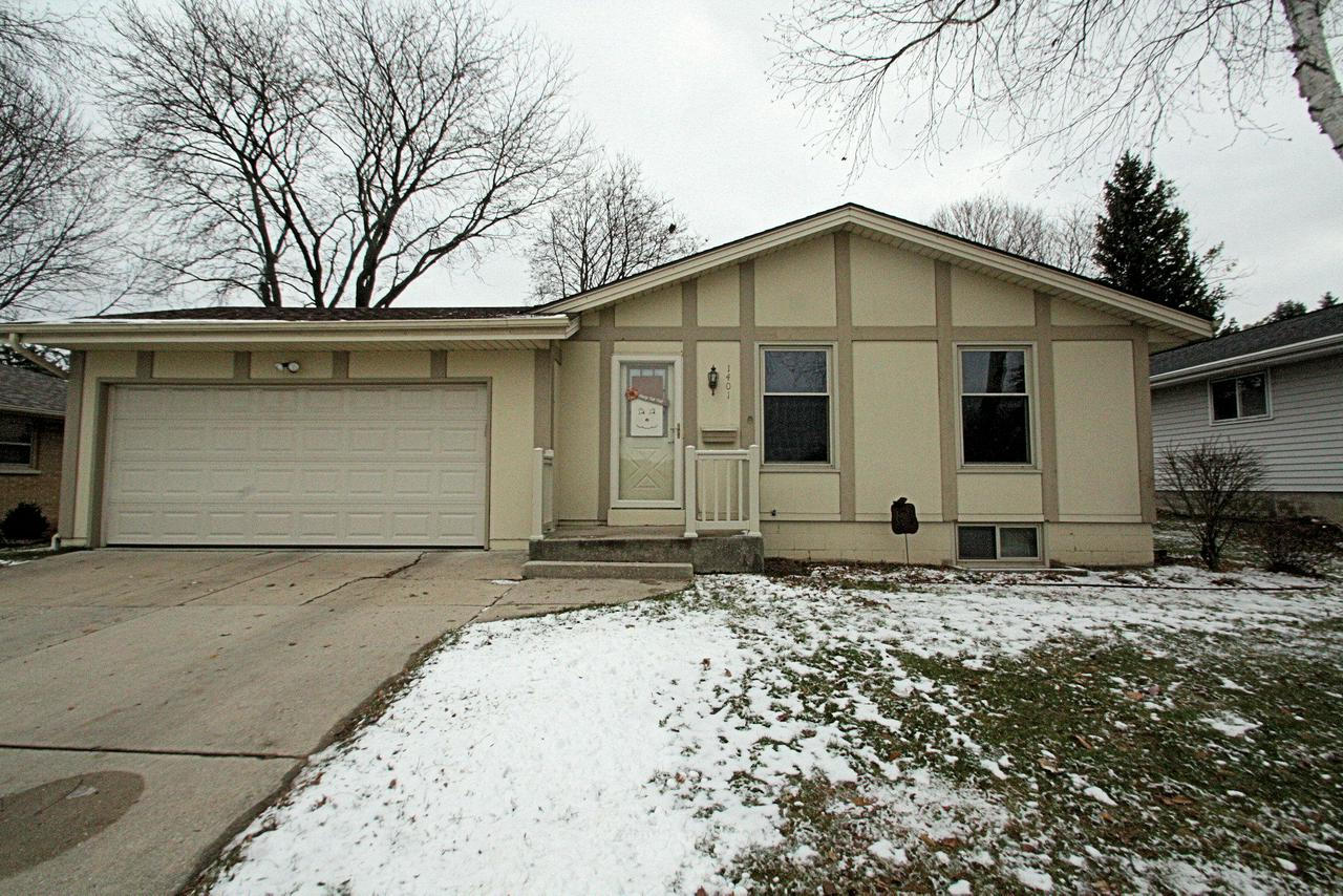 Location, location.  3 BEDROOM 2 FULL BATH RANCH with 2 CAR ATTACHED GARAGE right across from Silverbrook School.  Beautiful kitchen has refinished cabinets, solid surface counters, and all stainless appliances including convection oven, over the range microwave, french door refrigerator and dishwasher plus newer wood laminate flooring. Sunny Living Room opens to dining room ''L''. Open stair to lower level makes entertaining a breeze with kickback space for a man cave or kids play area plus bath with walk in shower. Updates include tear off roof-2012, A/C 2018, Water Softener 2016, and Newer Water Heater.  Relax on the newer concrete patio with lovely private back yard views.  Convenient to downtown West Bend plus easy freeway access.