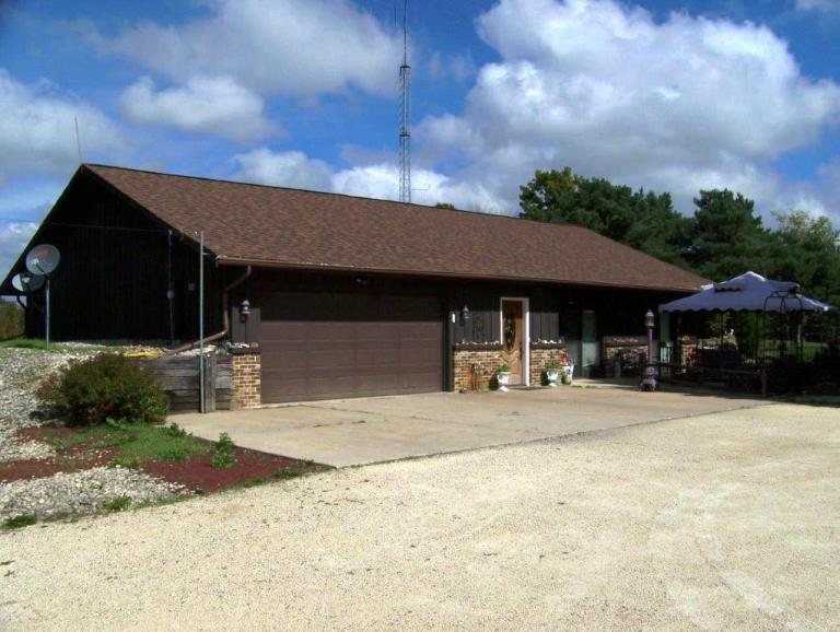 2-1/2 acre pond; insulated 40'x80' Cleary building about 24 years old with two 12'x16' doors, 200 amp service, an office with electric heat, a/c, a tool room, family room and a 2 car garage.  Complete building is steel with double steel roof.