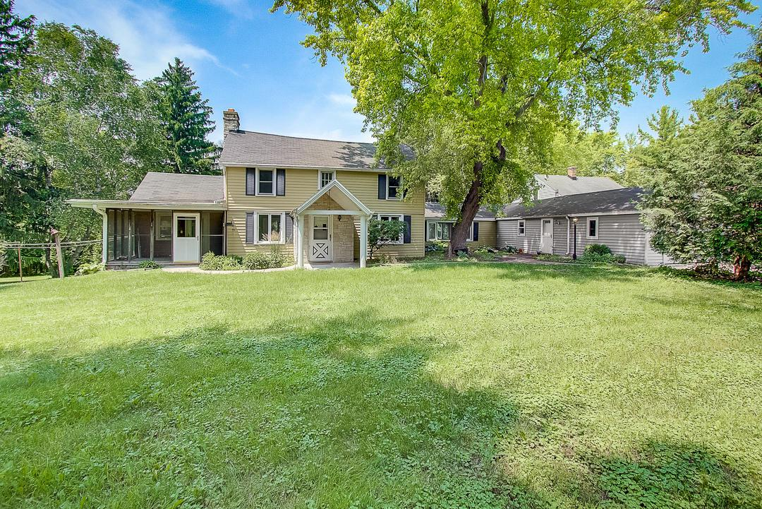 $370,000. Enjoy the simple pleasures of country living in this breathtaking & scenic 9.69 Acre farmette just East of West Bend in the sleepy Village of Newburg. This 4 BDRM home was originally built in 1850 & features original aspects of yesteryear including restored log walls, exposed log beams, HWFs & Prairie style Wood Burning FP.  Large Kitchen makes for easy meal prep & features charming white Cabinetry & includes Stainless appliances!  Convenient main level laundry comes with Washer/Dryer package. Master Bedroom on main features cathedral ceilings!  Additional separate 760sqft charming Cottage is ideal for overnight guests & includes an attached GAR, 1 BDRM/1 BA, a full Kitchen, LR & storage below! Complete the package with a Classic Red Wisconsin Barn ready for your creative ideas!