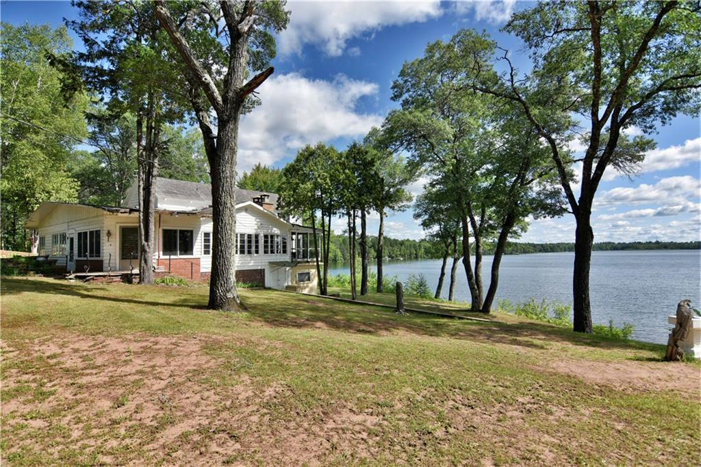 20 gorgeous acres, 578' pure sand lakeshore, commanding views, total privacy, 14' water clarity, excellent fishing, a true sanctuary! Vintage home with interesting character, qualities, history, guest cabin. Land full of wildlife, trails, natures sounds. Includes virtually everything on site, garden tractors, atv's, boat, tools, turn key! Home needs roof, general maintenance, however land alone is market valued at 550k. Potential to sell a couple 1 acre lots w/o affecting privacy, retain acreage