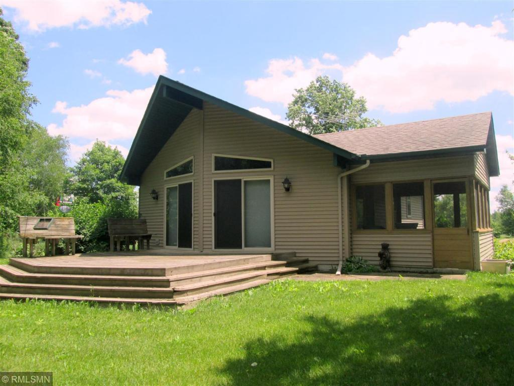 Rare opportunity to own this hunting paradise!  93 acres of woods, ponds, cropland and deer stands.  Easy access off State Hwy 63 North of Clear Lake, WI but set back on long private driveway which leads to a great hunting lodge and ultimate privacy.  Comfortable modern built home with detached garage for storage of all your hunting gear.  Pool Table included.
