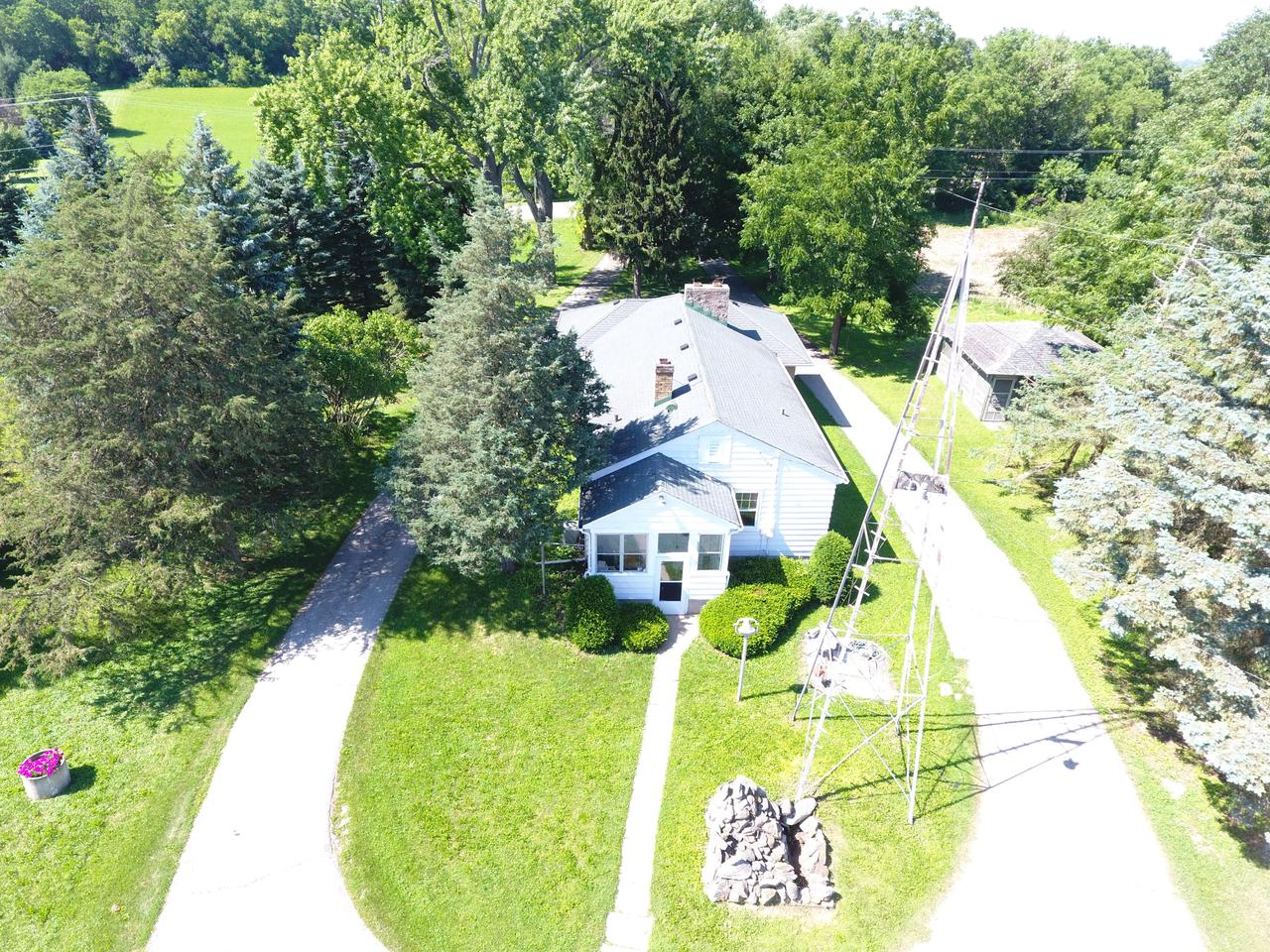 This 3 bedroom home sits on just over 10 acres of land.  Plenty of outbuildings to store all your toys or space for animals. Dairy barn is 75X23 with a lean-to of 60X27.  Additional outbuilding is 135X35. Call today for your private showing.