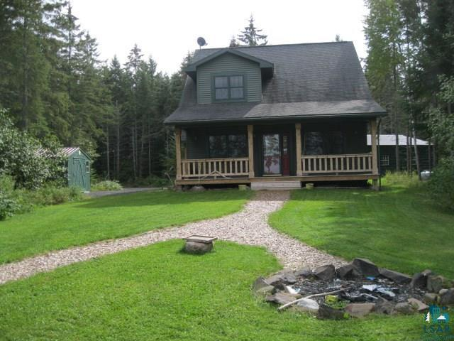 """Attention Buyers...Not only is this a beautiful home-it is the best deal out there! Immaculate year round home that would serve just as well as a getaway cabin. Main floor living with open floor plan concept. Spacious yet cozy feel to the home. Lots of windows allow natural light in AND gorgeous Lake Superior views/sunsets. 36x30 detached maintenance free garage with 16x9 large door and 2 others along with 8 windows for good lighting. Nice storage shed and another down the drive. Handsome front porch, loft area for additional living or guest space, dry crawlspace for storage. 450 feet of Lake Superior frontage across low volume traffic Hwy 13 in friendly Port Wing. This is truly a must see and literally """"priced to sell""""!"""