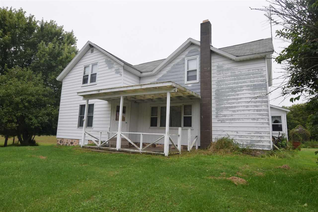 Farmette w/6-bedroom home, 24x58 machine shed/4-car garage, and 40x80 2-story barn w/addition on approx 15 acres. This is the perfect property for a buyer who loves to use his/her creative touches. Lots of square footage! The main level has a living room, large eat-in kitchen, huge 15x16 entryway, 3 bedrooms, and 2 full baths. There are 3 bedrooms on the upper level. So much potential!