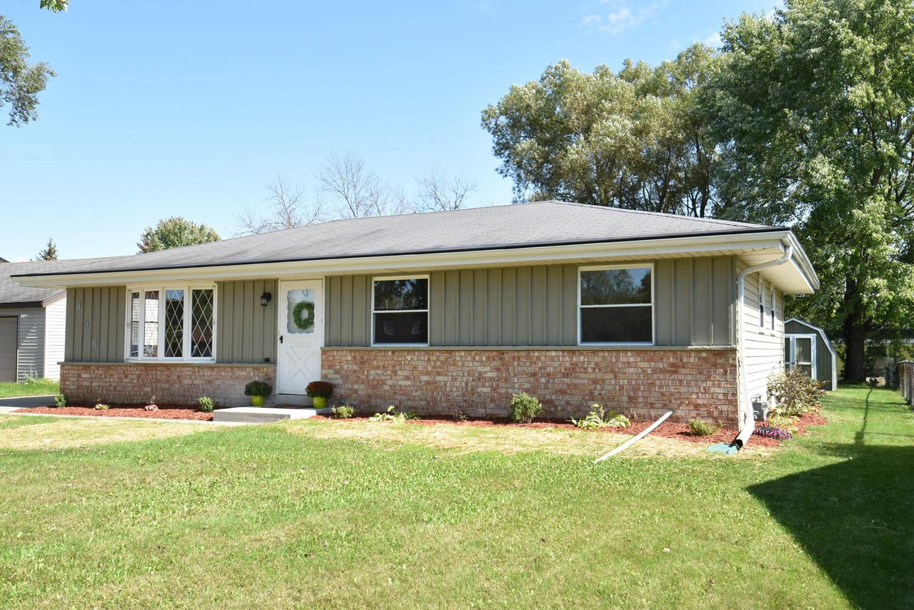 Just move in, nothing to do here!  This freshly painted inside and out, 4 bed/1.5 bath ranch home has hardwood floors and many updates.   Bright kitchen has newly painted white cabinets. All new ....stunning countertops,  flooring and stainless steel appliances.  Bathrooms offer upgrades including new vanities and flooring with high end fixtures.  New central air, hot water heater and sump pump. Outdoor enthusiasts will enjoy the nice-sized backyard and patio along with new landscaping.   The concrete drive leading to the overlarge 2.5 garage is a great space for any hobbyist.  Basement is ready for your rec room ideas.  Convenient location close to restaurants, shopping and parks. Home Warranty included.