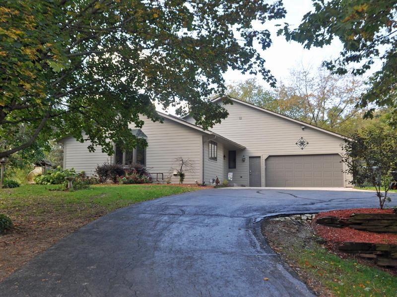 IN-LAW SUITE. Main home-Great 3 BR, 3 BA open concept. Main level has bright kit/dinette open to LR cathedral ceilings. Sun room has french doors.Upper level has 2 BR's & full 2 BA.The REAL BONUS is a SEPARATE, PRIVATE in law suite which has open concept living area, kit/dinette, full bath, & Large BR, . Full basement awaits your rec room.Updates include,  Siding last 5 yrs, Roof last 10 yrs, Newer Windows, Leaf Guard w/ warranty, Carpets cleaned  10.19
