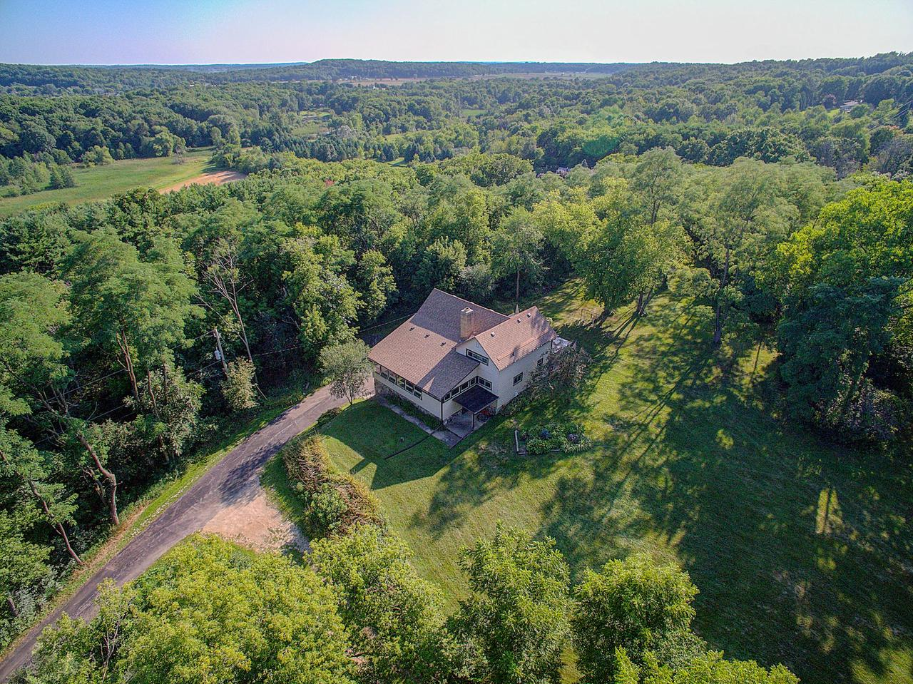 ''The Hill'' First time offered since 1967. Stunning private setting for this 7.28 Ac.  lovingly cared for and cherished family homestead, Germantown schools. Enter your private retreat on a long winding driveway. Your family and guests will love the impressively large great room w/stone natural fireplace, embrace the wooded rural views from the walls of windows. Make holiday memories in the huge country kitchen with center island. One BR & Den on the main floor. The upper level boasts three large bedrooms with HWF's. Plenty of room to roam; Large rear deck for cookouts. Photographic rustic barn foundation, silo & shed. Views for miles! A rare opportunity to make this house your home. Recent updates include; roof, windows, insulation, furnace and all new flooring on the main level. Welcome