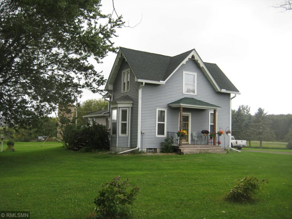 Rolling valley views from this charming farmstead. House features maintenance free steel siding, gutters and a new steel shingle roof. The interior boasts newer appliances, water heater, oak floors in the dining room, and a new water softener. Home has an outdoor wood burner (2011) which also provides hot water in addition to the forced air LP furnace. Outbuildings include 42 x 64 machine shed with power, water, partial concrete and new steel siding. A 24 x 24 detached garage with new steel and a 12 x 12 w/concrete, power and new steel siding. Perfect hobby farm or purchase up to an additional 65 acres (approx. 23 wooded/42 tillage) opening up endless possibilities.