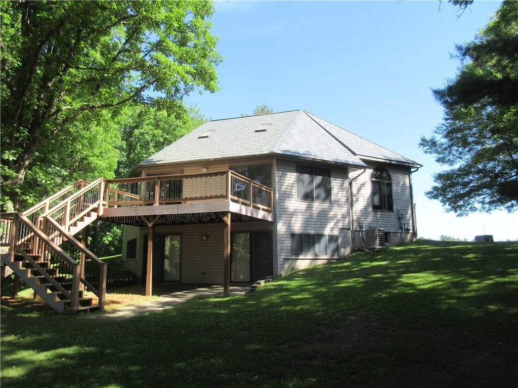 Incredible 3 bedroom home on 131 acres and over a mile of frontage on the Apple River. Very private setting. 1/4 mile off the road. Great fishing, incredible deer and turkey hunting. Nice mix of super mature timber. Soaring pine and 200 year old oak trees cover the landscape. Over 30 acres of tillable for income! Lifetime metal roof and maintenance free exterior will give you plenty of time to enjoy the sights and sounds of the Apple River. This property is definitely an Outdoor lovers dream !!