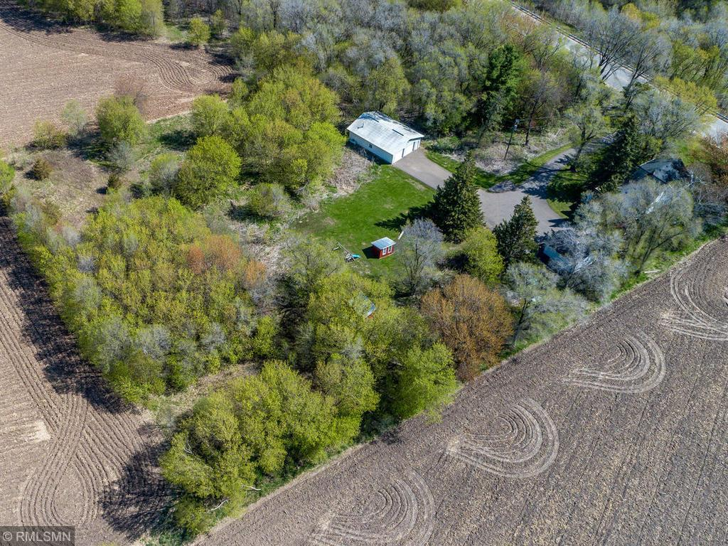 """For the home based business, permit goes with the property for Auto Body repair - there is a 30' x 40' heated shop with 6"""" insulated walls, paint booth, and 8' high overhead garage doors. Nestled on 3.23 acres with an abundance of space for gardening and family events, this charming home offers a tranquil location with easy access to nearby cities of Hudson, River Falls and Prescott. Outside you will enjoy the fire pit, small sheds for animals or storage, fruit trees, berries, and serene country living surrounded by farm land on all 3 sides.  The 16' x 12' covered porch welcomes you inside the house, where you may relax in front of the stately stone fireplace with a wood burning fire.  Numerous mechanical systems have been updated over the 25 years this owner has enjoyed the property.  Imagine making this your next home!"""