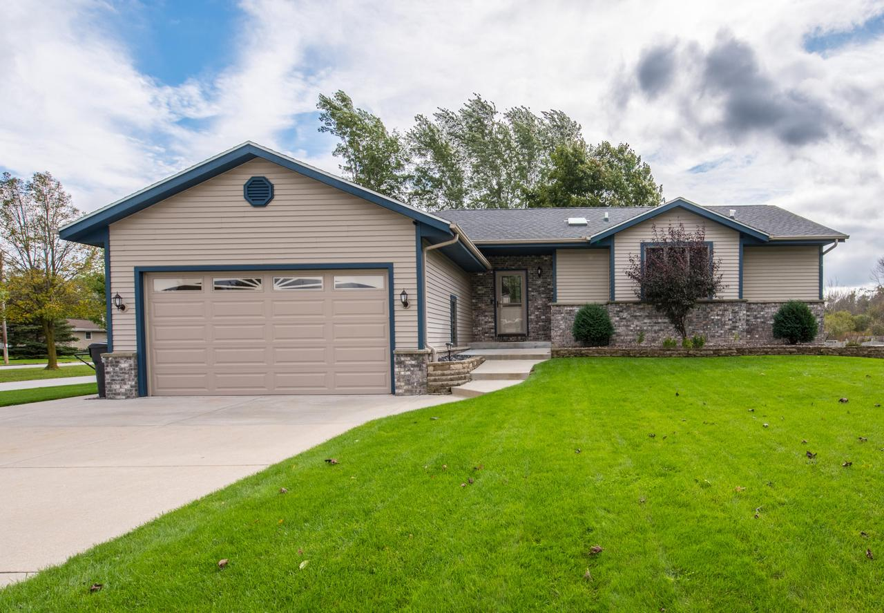 Beautiful & fully updated, this is a fantastic turn key Ranch! Located in a quiet subdivision that is close to parks, schools, shopping, and entertainment. This home features a bright  kitchen, beautiful patio, large back yard, and a fun lower level that features a large rec room and fitness room. This house is perfect for entertaining guests or relaxing with your family.
