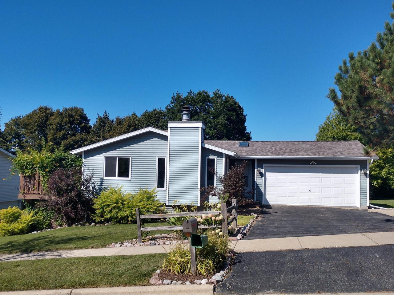 NEW PRICE! You will want to schedule a showing before this move-in-ready home is snapped up! Built in 1992, this 3 BR, 2 full BA ranch home features new carpeting, fresh paint, NFP, and lots of new windows. Master BR has WIC and private BA. 2nd BR also has WIC. Eat in kitchen with breakfast bar has patio door leading to a semi private raised deck. 2nd deck also includes a bon fire patio. Enjoy a fenced in garden, shed, and extra storage space under raised deck.  Bring your ideas to the walk-out lower level with new French patio door, 3 sliding windows, and 12 course height, plumbed for additional bath. Roof 2014. Water heater 2017. Furnace 2013. 2 1/2 car attached garage includes extra space, 2 work benches, and is insulated. Villa Park city park is right up the road.
