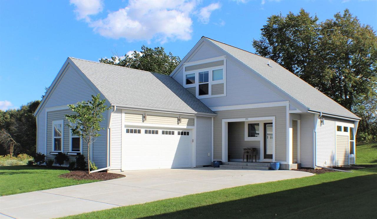 ONLY ON THE MARKET DUE TO JOB RELOCATION.  STUNNING 4 BED 3 BATH CONTEMPORARY HOME WITH MAIN FLOOR MASTER BEDROOM W/WALK IN CLOSETS. GREAT ROOM AREA  HAS ENTIRE WALL OF SOUTH FACING  WINDOWS BUT STILL RESPECTS YOUR PRIVACY.  GOURMET KITCHEN HAS WALK IN PANTRY, ISLAND,UP GRADED  STAINLESS  STEEL APPLIANCES. 2 BEDROOMS AND A HOTEL-LIKE BATH SUITE ARE ON PARTIAL UPPER FLOOR.  LOWER LEVEL IS FINISHED WITH WET BAR, LARGE ENTERTAINMENT AREA,  BEDROOM AND FULL BATH.  EXCEPTIONAL QUALITY THROUGHOUT ENTIRE HOME.  COME EXPERIENCE THAT CITY-URBAN MODERN LIVING FOR YOURSELF,  THIS HOME WILL NOT DISAPPOINT.