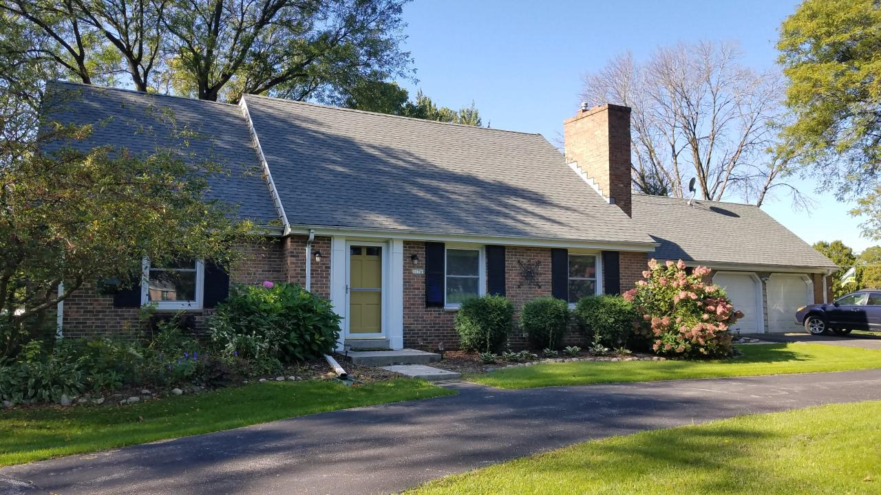 This charming Cape Cod is located on just under an acre. Beautiful landscaping within the enclosed pool area. Roof only 2 years old and the furnace and AC only 1.5 years. The slate foyer leads you into the living and dining rooms with natural fireplace and dining room L with built-in corner china cabinet. The family room with fireplace is a perfect place to watch what is happening on the patio and pool area. Two bedrooms on the main floor and two bedrooms upstairs with ample closets lets you choose if you want up or down. The  water softener and iron filter are owned and will remain. This is a great home in an excellent location on a beautiful lot. Don't wait because it won't be around for long. HSA Home Warranty included.