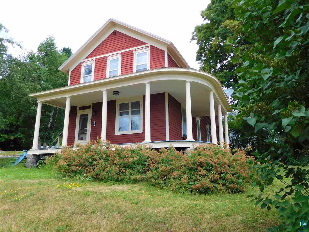Outstanding Views!  With one of the best views in all of Bayfield, this Victorian-style home is perched on a spacious, corner lot with The Lake, and views of the Apostle Islands from almost every room in the home. Now?s your chance to own a property like this in the sought-after location of Bayfield!  Bright and charming this home retains the special character of its era; such as maple floors, leaded glass windows, high ceilings, an open staircase and Lake Superior views. The main level has a kitchen, den/bedroom, dining room, living room and half bath. The upper level has a bedroom with large walk-in closet that could double as an office, 3rd bedroom, sitting room which could become another bedroom and a very, spacious full bathroom with walk-in closet.   Relax on the wraparound porch and watch the Madeline Island Ferry and sailboats glide by. The spacious yard offers plenty of space to play & garden.  This prime location across the street from the historic Iron Bridge and just blocks away from everything the City of Bayfield has to offer will welcome you home every day. After October 14th price will increase by $10,000 or more due to capital improvement projects.