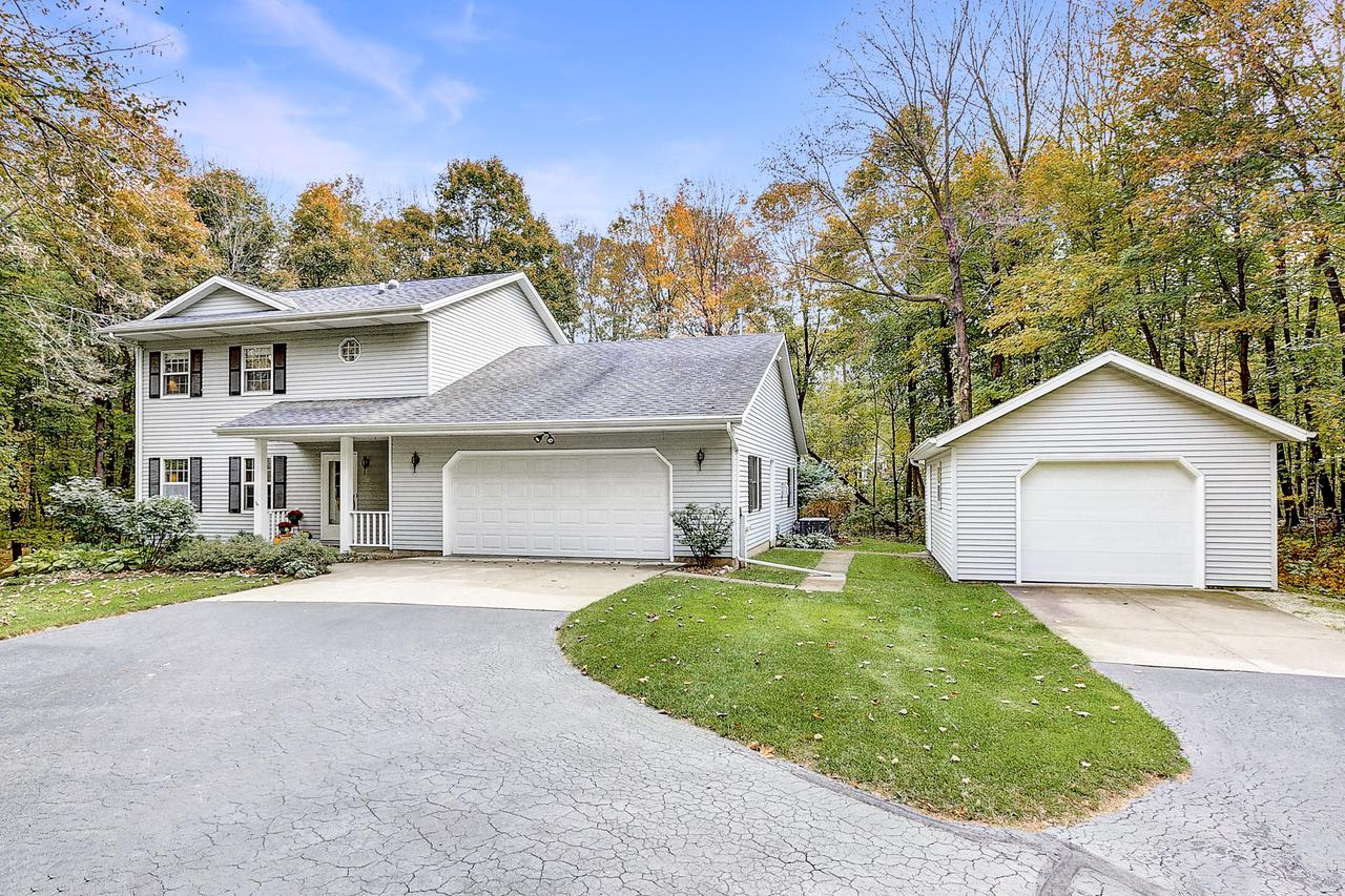 $359,900.  PICTURE PERFECT 3 BDRM/2.5 BA Colonial on PRIVATE, wooded 2.3 Acres at the dead end of a quiet cul de sac!  Meticulously maintained, this beautiful home features 2x6 construction, Andersen windows, 6 panel doors & striking Ash HW Floors.  Cozy sunken LR boasts Gas FP w/ stone surround, new carpeting & picturesque views of scenic backyard.  Updated Kitchen features Quartz Countertops, spacious Breakfast Bar, Birch Cabinetry, Stainless Appliances & large Pantry!  Convenient Main Level Laundry with Custom Closet PERFECT for small appliance storage. Updated Powder Room with granite countertop!  Spacious Master features private Bath w/ WIC.  Finished Walkout Lower Level ideal for entertaining! Handsome professionally designed stone patio!   2.5 Car ATT GARAGE + 1.5 Car DET GARAGE!