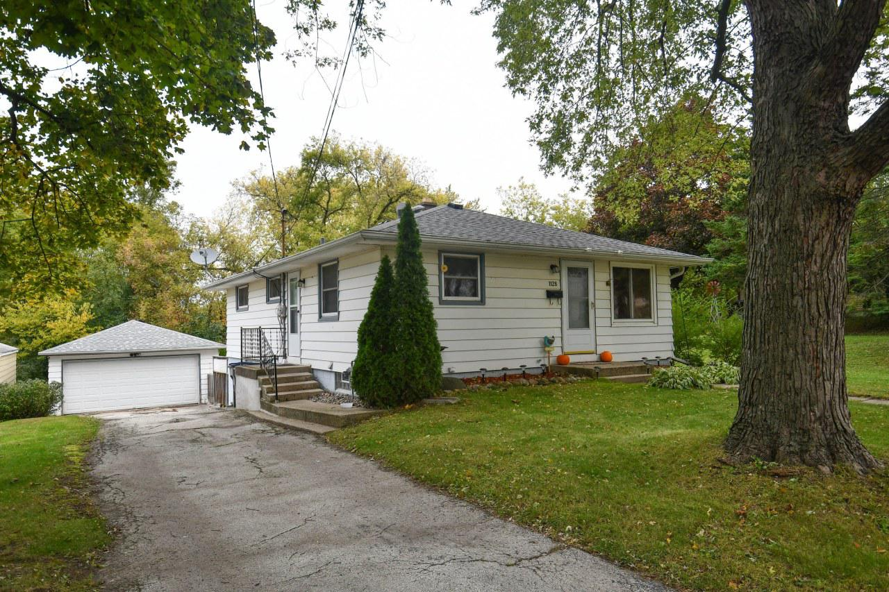 This super cute exposed Ranch has a NEWER roof on the home and the garage(2017), NEWER furnace (2015), water heater (2012). You will love the layoutof the home and the finished rec room and bar in the lower level. Patio doors lead to the fenced back yard, perfect to run andplay. Walking distance to Frame Park, and easy access to I-94!  This home home won't last long so schedule your showing today!