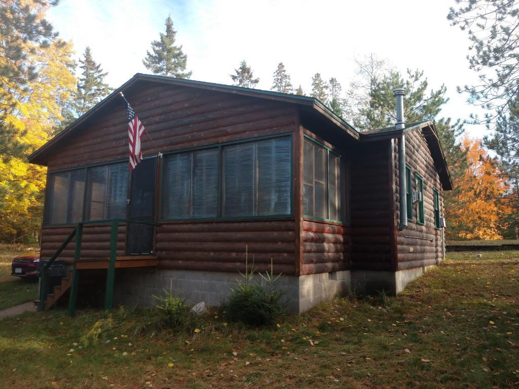 Lost Land Lake - Enjoy the simplicity in this well-kept, 4-season condo cabin. This 2-bed, 1-bath waterfront cabin with screen porch comes furnished.  Living room has free-standing gas stove.  Private dock and nice level play area on the grounds.  Association takes care of lawn and road maintenance.  Just a short distance to Lost Land Lake Lodge. Lost Land Lake is a quiet lake and known for excellent fishing and a wilderness feel.  Navigable channel to Teal Lake.
