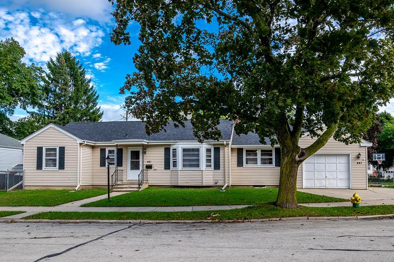 Located on a quiet West Racine enclave sits this great corner lot home. This 3bd/1.5 bath home has a bright and airy feel from the moment you walk in the door. The front room features a natural fireplace to keep you warm and cozy on those up coming Autumn evenings. The large family room connects with the kitchen and front room. Generous room sizes. Oak hardwood floors throughout and the larger than it looks feel, make this home perfect for family gatherings. Lower lever features two semi-finished bonus rooms with a half bath in the dry basement. Enjoy sipping your morning coffee on the covered back porch or grilling during the football game. Fenced in backyard, storage shed, newer roof and approximately 3 year old furnace make this a great opportunity.