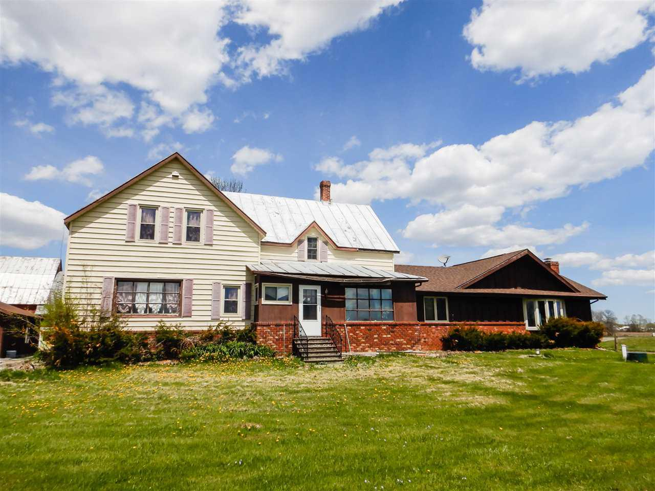Country Living at it's finest! Plenty of room to run on over 38+ acres of mostly farmland with some wooded areas. Start a hobby farm or raise horses. This property is set up for many uses. 9 outbuildings including 3 barns for all of your storage and farming needs. This 2 story huge home offers 6 bedrooms 4 in upper,2 on main level,3 full baths,2 living rooms and large kitchen/dinning room. Vaulted ceiling living room area with brick wood burring fire place leads to indoor heated (inground)year round swimming pool. Basement finished for rec room. There is so many possibilities! Come check out!