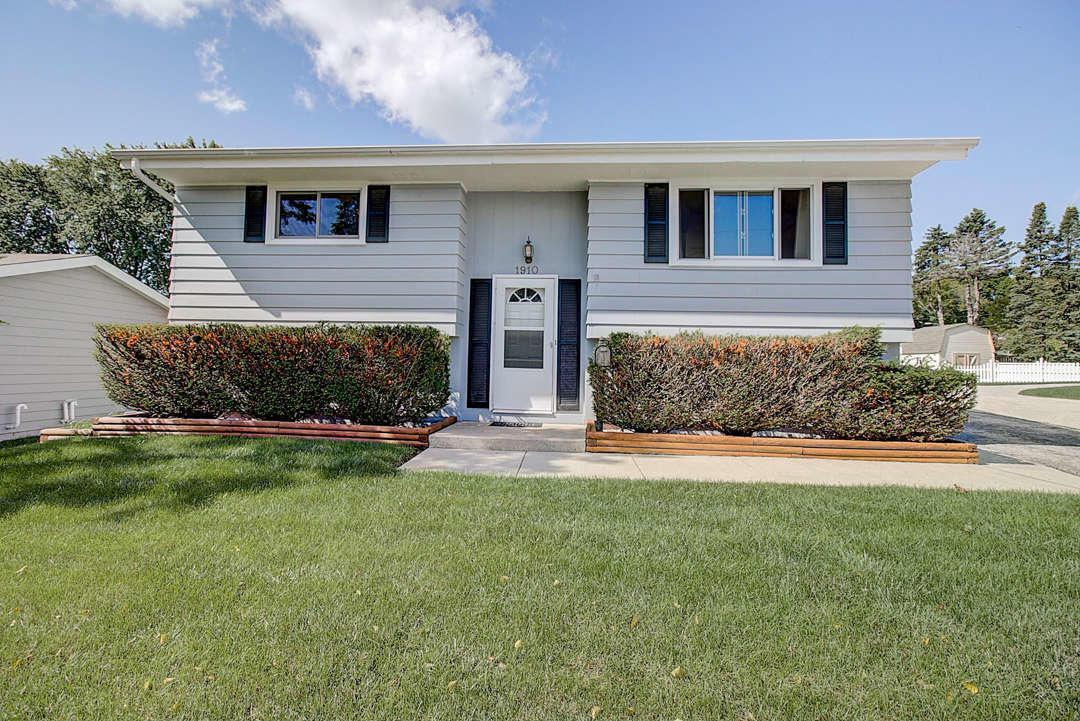 Move right in to this bright and clean four-bedroom home in one of Waukesha's most convenient locations! Hop on I-94 in less than five minutes, while having the piece of mind of being located right across the street from the Waukesha Police Department. In the summers, walk to the fireworks on the Fourth of July and to the Waukesha County Fair! Twenty years of pride of ownership shines through in this home: including updates to Windows and patio door (2018), Garage (2010)--see full list of seller updates. The fourth bedroom works great as an office or additional storage space. Outside, relax on the freshly stained deck and the large, park-like backyard. There is plenty of bonus storage in both the shed and the garage. Seller's are including a home warranty so you can move right in and enjoy!
