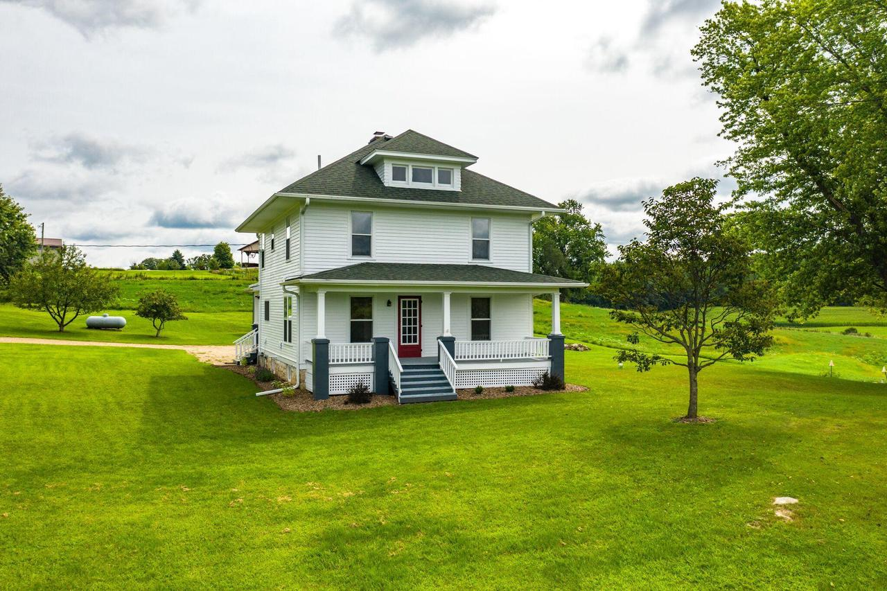 Beautifully updated 3 story farm house on 6.5 acres just 7 miles from Viroqua! Enjoy the country life close to town with this 3-4 bed home! Original hardwood floors welcome you as you enter and are surrounded by tons of natural light. Open living/dining room, main floor laundry with 1/2 bath. Stunning updated kitchen perfect for entertaining with brand new appliances! Enjoy the large master bedroom with walk-in closet. Walk -up attic for additional space! This house is a stunner and sure to please! Give us a call today!