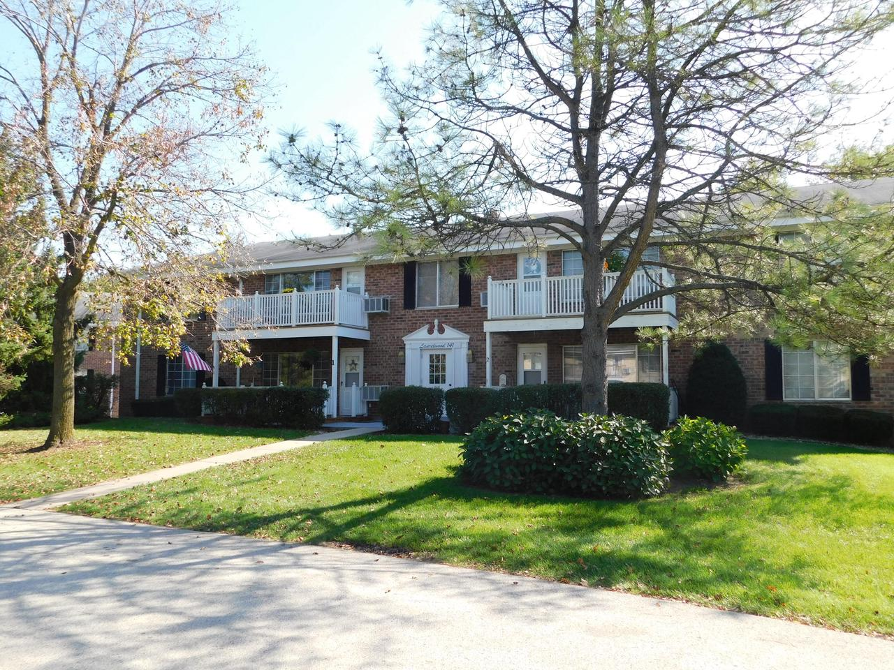 Exceptional and well maintained second floor unit in move in ready condition!  Enter the unit to an open concept design with a huge living room and dining room + a large picture window and access to balcony deck area.  Spacious working kitchen with lots of cabinets, working space + SS appliances.  Main full bath with tile floors, granite and LAUNDRY area !! Master bedroom offers walk in closet and private 1/2 bath with tile. Second bedroom has great decor and a double closet.  Bonus office/den room with a large closets.  This condo can be rented as a investment  opportunity.  Lower level garage offers one assigned parking spot and one assigned surface plus Storage Locker.  A must see unit !!