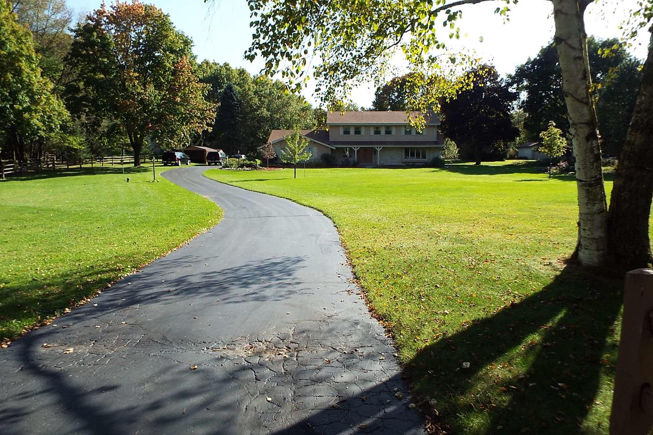 Beautiful Holy Hill area, Erin subdivision 5 bedroom home on almost 2 acres, well maintained great location ,30 miles north west of Milwaukee and 5 miles south of Hartford and 2 miles to Holy Hill, See deer and wild turkey in your back yard while drinking your morning coffee                          Also 2 out buildings, one small and one large enough to store your boat.