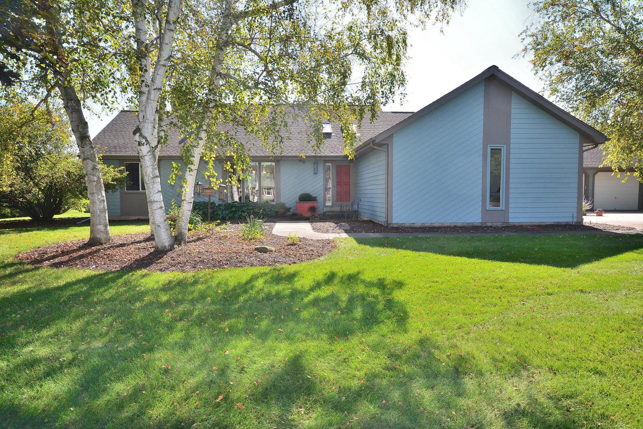 Perfect combination of space, location and privacy. This 4-bdrm home sits on 2+ acres at the end of a quiet cul-de-sac. All bdrms on main level with 2 full baths, living room with HWFs, gas fireplace & skylights, kitchen and dining area both have ceramic tile floors and patio doors.  Additional living space in lower level with rec room, exercise/bonus room, wet bar and half bath.  Perfect backyard setting for entertaining...huge 800 sq ft deck (with all new decking) incorporates the above-ground pool and steps down to the big yard.  Detached 28' x 28' garage (heated & cooled), garden shed with 2nd-floor playroom/loft, and a completely fenced yard. Home was built with a passive solar design allowing natural light to fill the rooms and significantly reduce heating bills in the winter.