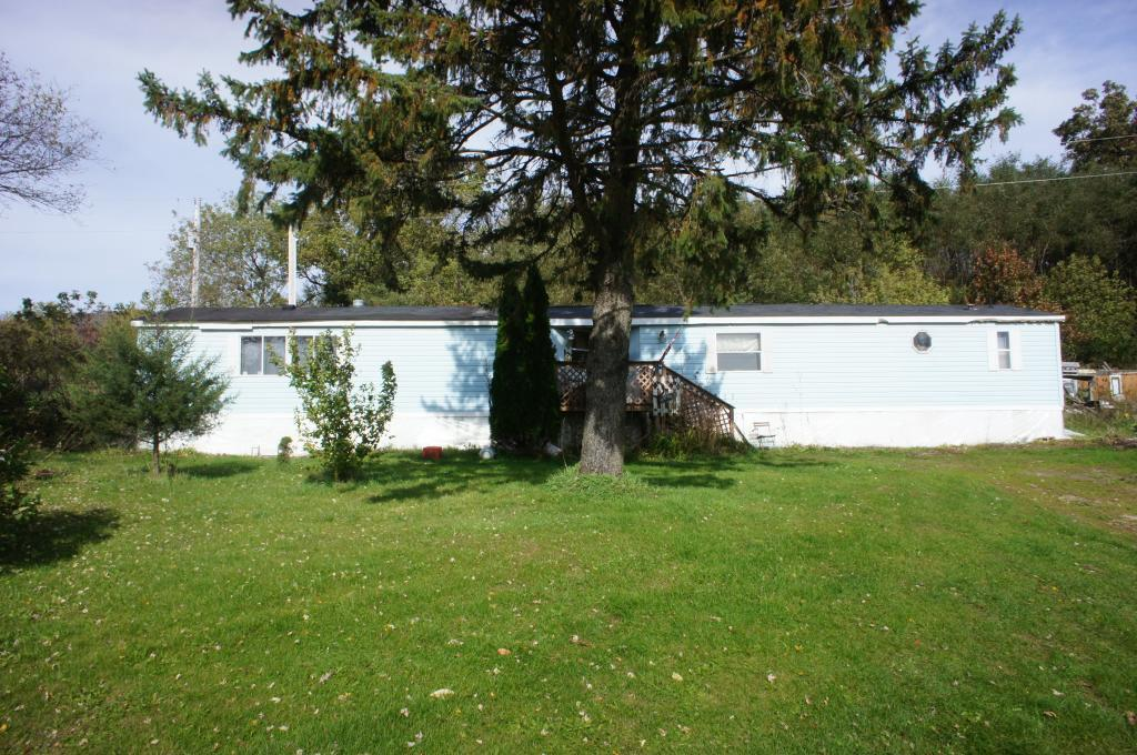 Less than Rent - 3 bedroom, 2 bath 16x80 manufactured home sitting on 1 acre in the hills of Buffalo County. Perfect for that get-a-way location? Maybe a great investment opportunity? What is your need?