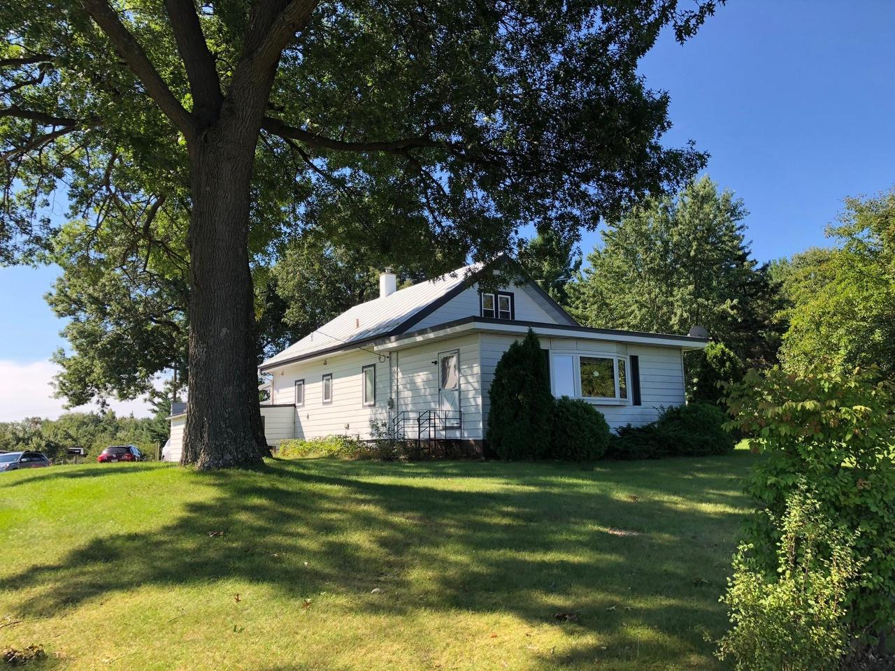 This is an ideal location! It is a blank canvas for a buyer to come in and redefine.  Across from a new development, so growing on to that is a possibility.  Or a great location to continue its original use, as a small farmette.  Horses, cows, chickens...Minutes from all Tomah has to offer, and yet country.  A must see!  House has small attached garage.  Septic to be replaced upon a solid accepted offer.