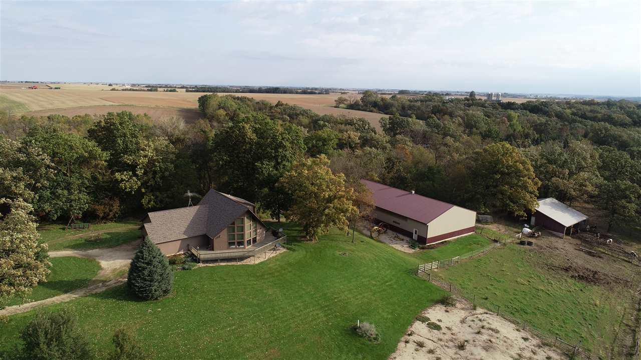 Here's a great little farm to bring your animals to and bring your hunting gear to as well! There are 54 acres with 30 tillable acres and balance is pasture & woods. This was a well built home with a fantastic view out of the great room, and a huge deck that wraps around a good part of the house, and a nice yard with apple & pear trees. And you get a 50' x 96' machine shed and 32' x 40' horse barn!   Sellers to retain occupancy of property until April 1, 2020. Tillable acres leased through 2021 crop season for $200/tillable acre.  24 hour notice preferred for showings.  Additional tax parcels.