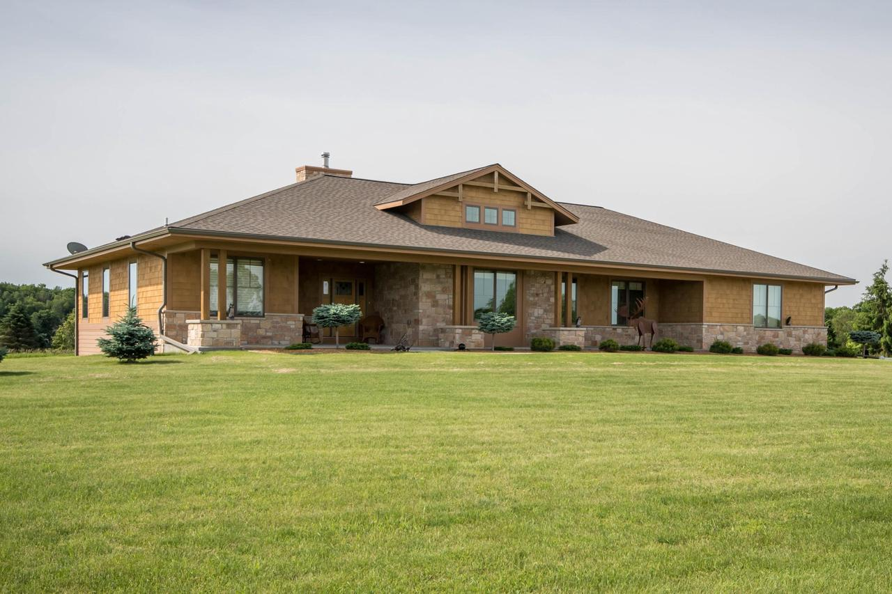 Beautiful Ruebl Builders custom Ranch on 5 acres. The kitchen has gorgeous granite, stainless steal appliances, HWF, large island, built in desk & dinette that looks out at the back yard's amazing views of nature and abuts Lake Beulah  golf course.  The large family room has ample windows, 2 sided fireplace and tray ceiling.  4 Large Bdrms, 2 full & 2 half bathrooms. Master has a WIC and private bath w/ dble sinks &  tile shower. The LL is finished providing so much extra living space w/a wet bar, fireplace, 2nd family room, bdrm and 1/2 bath that can be converted to full. Stairs leading from the basement to the 3.5 car garage w/epoxy floor. Soft close cabinetry, tank less water heater, zone heating, central vac, Anderson windows, cement board siding are just some of the amazing upgrades