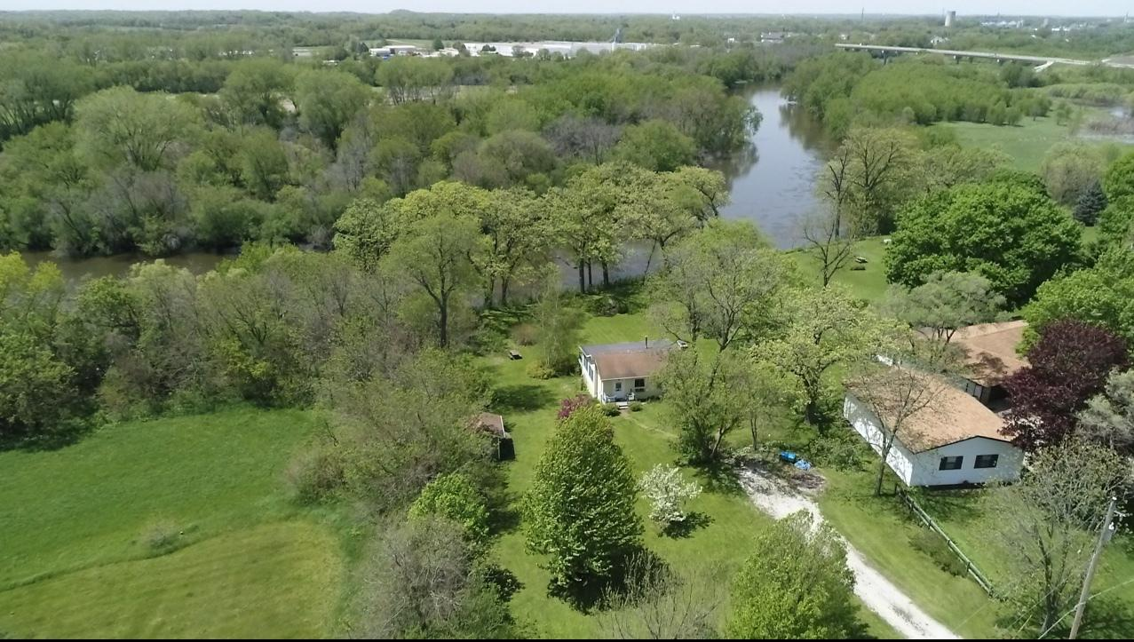 Adorable updated home sits atop a hill with unbelievable Fox River and sunset views. Imagine watching the sunsets on your expansive deck or in your heated sunroom.Relax and watch the ducks, cranes, and various birds fly by and fish jumping in the river off your 124 feet of private frontage. Everything has been updated and remodeled including the roof, siding, appliances, with fresh paint throughout. The house can be fabulous as a full time home or an ideal vacation home or VRBO. Located 7.8 miles away from the Richard Bong State Recreation Area or 2 miles from downtown Burlington, you will not be disappointed!