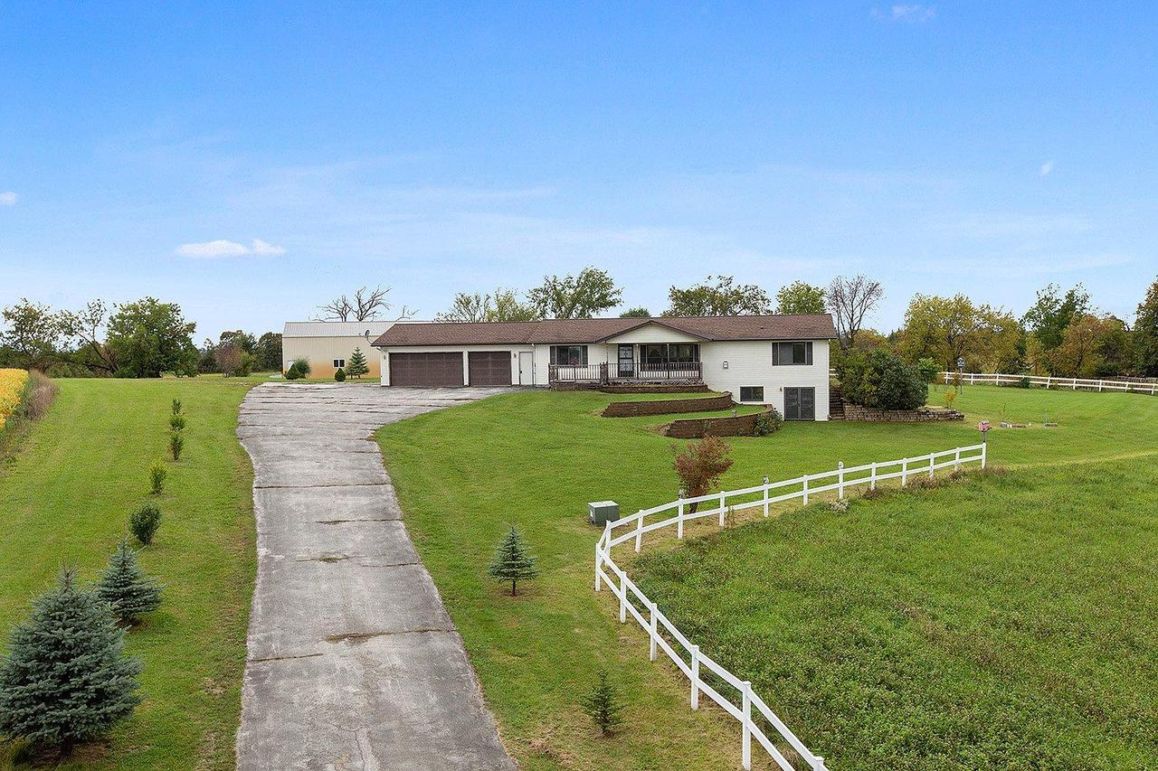 SET OFF THE ROAD is this walkout ranch w/5+ acres (35 acres available) just over the Sheboygan County line just a short drive to Kiel or New Holstein.  Built in 2002, this one-owner home needs a new owner!  Perfect for a hobby farm, horses or just enjoy the country.  Sprawling ranch w/over 2400SF, master suite w/dbl sinks, living room w/vaulted ceiling & fireplace, BIG kitchen w/endless counters & cabinets, SUNROOM w/pine ceilings & walls, 1st floor laundry, LL is walkout w/3 extra rooms that could be guest rooms, office or storage.  30x64 detached pole building. 30x40 of it is a heated workshop.  A 24x30 separate area was for horses.  See it now!