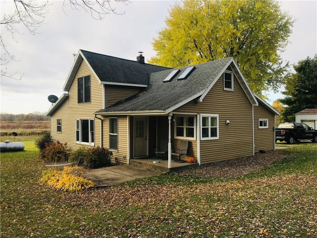 Your next home awaits! Charming farmhouse with over 5 acres south of Eau Claire! Eau Claire schooling, low taxes, and close to town! Many out buildings and land for storage, hobby farm, and more! Updates include new A/C '13, well pressure tank '17, hot-water heater '18, septic drain-field '13, Furnace '13, Electrical '13, doors '17, trim '17, leveled floors and new subfloor '17, insulation '17, fridge '19, washer '19, and more. Don't miss out - schedule your private showing today!