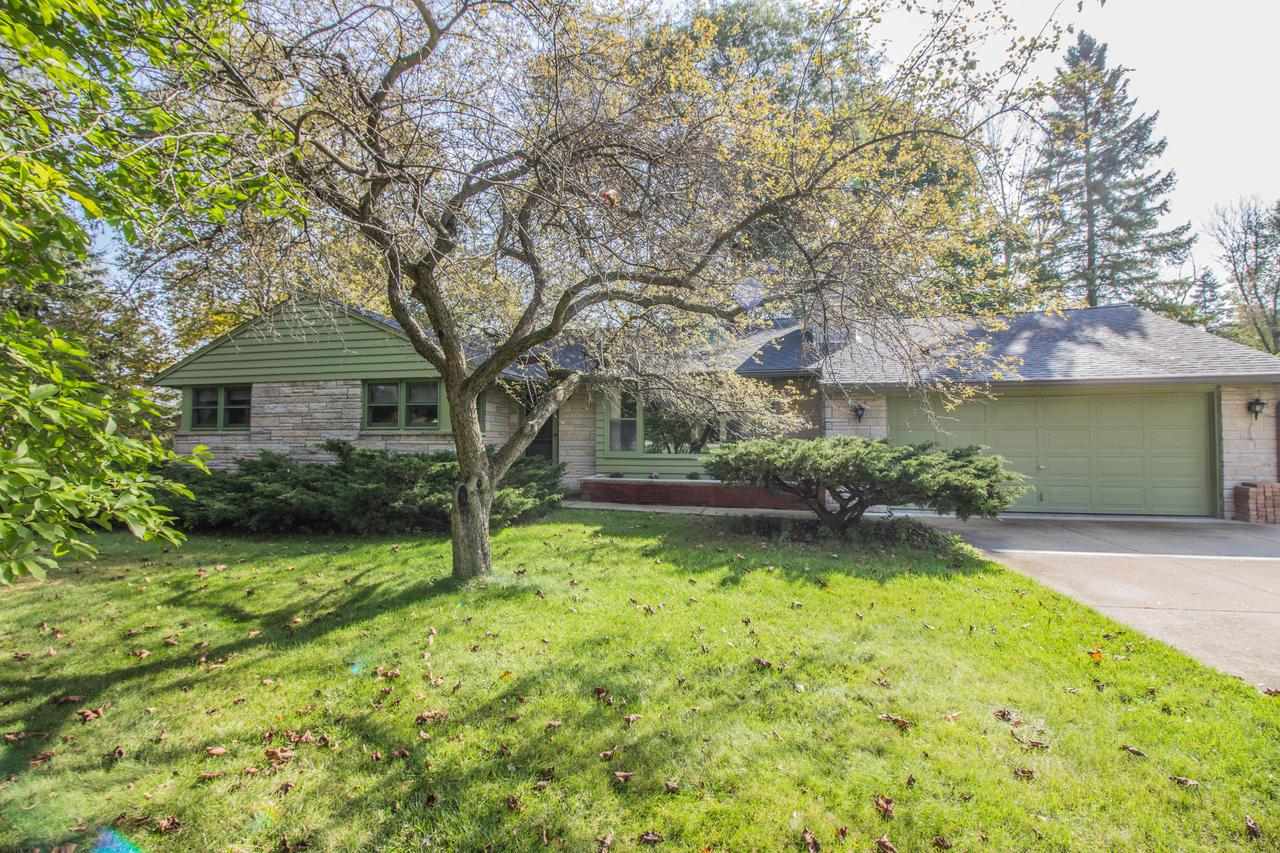Lovingly cherished & tenderly cared for this mid century modern ranch has 3 BD, 1.5 BA & is on the market for the first time in 40+ years. You'll enjoy the low maintenance lannon stone facade that is nicely situated on over an acre of land in a mature/quiet subdivision.  Updated kitchen is bright & cheery with custom cabinetry, recessed canned lighting & ambient above cabinet lighting. The family room has a massive front window & stunning natural fireplace with a gas line.  Relax & enjoy the abundant wildlife in your 3 seasons room.  Entire interior has just been painted w/ neutral colors. Be a part of the award winning Mequon-Thiensville School District. Home is ideally located & close to everything Mequon has to offer.  Excellent proximity to I-43 for commuters. Make this your own.