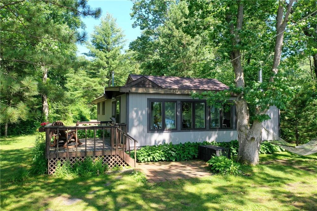 This charming, renovated 3 season, 2 bedroom cabin w/ southern exposure, is a prime example of what the Northwoods is all about with its breathtaking views of Little LCO, gradual sandy swimming area, amazing fishing, and access to world class mountain bike and ski trails. Little LCO is quieter than the ?big lake,? but is connected by a channel for easy access to big lake fishing, cruising and restaurants.  The cabin features beautiful hardwood floors, cozy living room with freestanding wood burning fireplace, incredible lake views, kitchen with all the amenities, large dining area, and an updated bath. New septic Fall of 2018, new drilled well (with excellent drinking water) in Spring 2016, bathroom remodel in 2015.