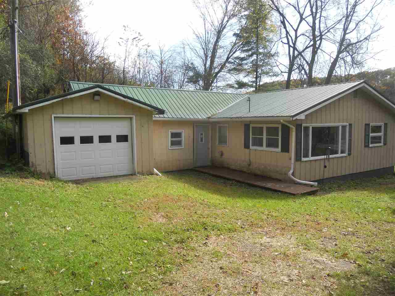 This 3 bedroom, 1 bath,  house/cabin sits on 12.23 acres. It features an attached garage, metal roof, new electric update, central air, and a detached 26 x 36 shed. The property also provides an excellent place to hunt. The property lines create a natural funnel for deer to move through and several deer trails converge on the acreage. You need to see it to believe it! It is also currently in in a closed managed forest program.