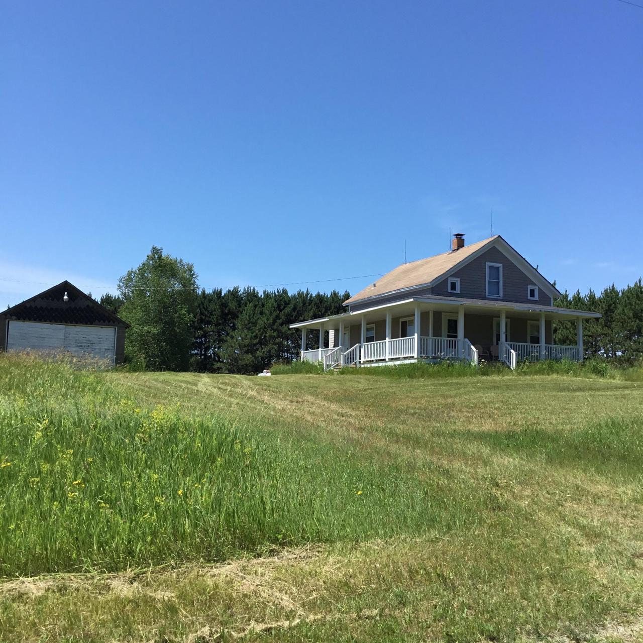 Just Reduced- New Septic 08/06/2019Sit back and enjoy the country scenery and smell the country air as you relax on the 6 x 54 wrap around porch with  updates done in the 90's to this  farmhouse. So many happy memories where made in this home that date back to the 1920's when it was once farmed. Nicely border with mature trees and flowered fields . Home has farm style eat in kitchen with updated cabinets, newer floors that carries into the dining room. Arch door way ,wood doors & trim. There's a bedroom/den on the main floor along with washer and dryer, living room, full bath (porcelain) tub and plenty of storage with 3 additional bedrooms upstairs. Poured basement with 8' ceilings , two car garage. LP tank is owned
